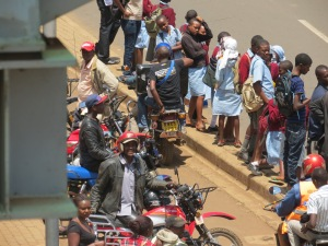 Public school children wait for the matatus